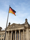 Reichstag in Berlin wih German flag Royalty Free Stock Photography