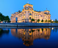 Reichstag building in berlin germany at night parliament with reflection spree river Royalty Free Stock Photo