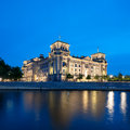 The reichstag building at night in berlin bundestag with reflection river spree Stock Photography