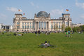 The reichstag building and vacationers residents and visitors on the field berlin germany april is a Royalty Free Stock Photography
