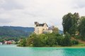 Reifnitz castle carinthia austria on lake worth in Royalty Free Stock Photography