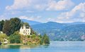 Reifnitz castle on lake worth in carinthia austria view of Stock Photo