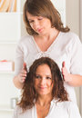 Reiki healing professional healer doing treatment to young woman Stock Images
