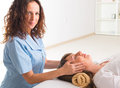 Reiki healing professional healer doing treatment to young woman Royalty Free Stock Photos