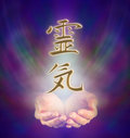 Reiki kanji and cupped hands healers symbol on misty background Stock Photos