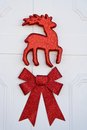 Reindeer and bow red red on a white background Stock Image