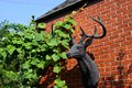 Reindeer head sculture hanging on the red brick wall