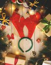 Reindeer Horns Headband Surrounded By Christmas Gifts Ornament Royalty Free Stock Photo