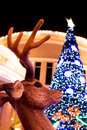 Reindeer and xmas tree background Royalty Free Stock Photo