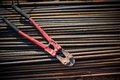 Reinforced steel bars and bolt cutter on building construction site tools objects Stock Photo