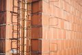 Reinforcement steel bars on pillars, walls and layers of bricks Royalty Free Stock Photo
