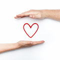 Relationship photo with two hands with red heart Royalty Free Stock Photo