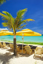 Relax area on beach with umbrella to shade from sunlight great for summer vacation background Royalty Free Stock Images