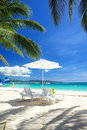 Relax area on beach with umbrella to shade from sunlight great for summer vacation background Royalty Free Stock Image