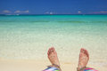 Relax on the beach man s feet relaxing with clean salt water Royalty Free Stock Photography