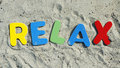 Relax on the beach written with wooden letters Stock Photos