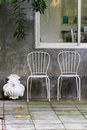 Relax corner in the garden with two chairs Royalty Free Stock Photography