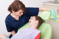 Relax kid laughing in dentist chair Royalty Free Stock Photo