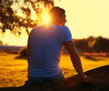 Relax lifestyle photo silhouette lovely man alone enjoying beautiful evening sunset sunny vintage colors Royalty Free Stock Photography