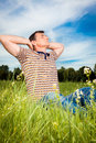 Relax man in green field Royalty Free Stock Photo