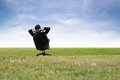 Relax man relaxing on chair in green meadow Stock Photography