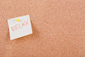 Relax note pinned to cork board Royalty Free Stock Photos
