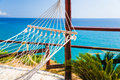 Relax in paradise hammock perfect place for white with tropical sea view Stock Photo