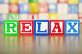 Relax Spelled Out in Alphabet Building Blocks Royalty Free Stock Images