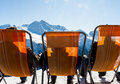 Relax three skiers relaxing in the sun enjoing the view of austrian alps Stock Image