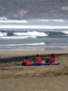 Relax after training lanzarote famara school surfing for girls rest on the beach Stock Photos