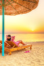 Relax under parasol on the beach of red sea at sunrise Royalty Free Stock Images