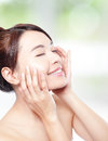 Relax woman closed eyes and finger point to concept for eye and skin care isolated over nature green background asian beauty Stock Photography