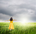 Relax woman in green rice fields with rainclouds bic Stock Photos