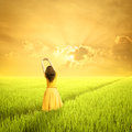 Relax Woman in green rice fields and sunset in the morning Royalty Free Stock Photo