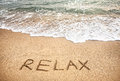Relax word on the sand beach near ocean Royalty Free Stock Photo