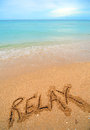 Relax written in sand Stock Photos