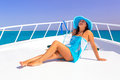 Relax on the yacht cruise beautiful woman in hat relaxing Stock Image