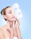 Relax Young woman with cloth facial mask Royalty Free Stock Photo