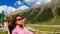 Relaxation in the alps beautiful young lady enjoying beauty of swiss mountains Royalty Free Stock Photography