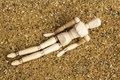 Relaxation artists dummy set in a position on a sand background Royalty Free Stock Images