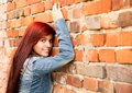 Relaxation in the city beautiful girl near brick wall smiling Stock Images