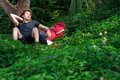 Relaxation on fresh air a young tired tourist napping in the forest the foreground Stock Image