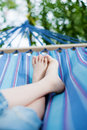 Relaxation in the garden unrecognized child relaxing hammock outdoors Stock Photography