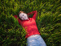 Relaxation a girl lying on grass Royalty Free Stock Images