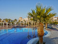 Relaxation luxury hotel holiday resort egypt africa swimming pool and palm trees near beach at in marsa alam Stock Photos
