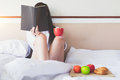 Relaxation in the morning reading a book and having breakfast. Royalty Free Stock Photo