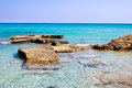 Relaxation place clear sea water and the big stones Stock Photos