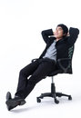 Relaxed business man sitting on the chair Stock Photography