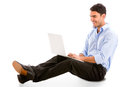 Relaxed business man working on a laptop isolated over white Royalty Free Stock Photography