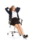 Relaxed business woman sitting on a chair with closed eyes. Royalty Free Stock Photo
